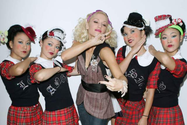 Gwen Stefani with Harajuku Girls during Gwen Stefani Visits MTV's ''TRL'' - December 10, 2004 at MTV Studios, Times Square in New York City, New York, United States. (Photo by James Devaney/WireImage)